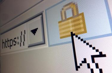 A lock icon, signifying an encrypted Internet connection, is seen on an Internet Explorer browser in a photo illustration in Paris April 15, 2014. About two thirds of all websites use code known as OpenSSL to help secure those encrypted sessions. Researchers last week warned they have uncovered a security bug in OpenSLL dubbed Heartbleed, which could allow hackers to steal massive troves of information without leaving a trace. REUTERS/Mal Langsdon (FRANCE - Tags: SCIENCE TECHNOLOGY CRIME LAW) - GM1EA4F1SZM01