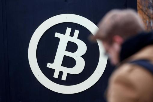 A bitcoin sign is seen during Riga Comm 2017, a business technology and innovation fair in Riga, Latvia November 9, 2017. REUTERS/Ints Kalnins - RC184DC8B2E0