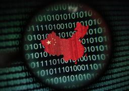 A map of China is seen through a magnifying glass on a computer screen showing binary digits in Singapore in this January 2, 2014 photo illustration. Picture taken January 2, 2014. REUTERS/Edgar Su (SINGAPORE - Tags: SCIENCE TECHNOLOGY BUSINESS TELECOMS TPX IMAGES OF THE DAY) - GM1EA170WMF01