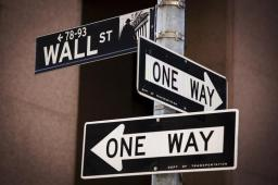A 'Wall St' sign is seen above two 'One Way' signs in New York August 24, 2015. Wall Street opened sharply lower on Monday with the Dow Jones industrial average losing more than a 1,000 points following a more-than 8 percent drop in Chinese shares and a selloff in oil and other commodities. REUTERS/Lucas Jackson - GF10000181447