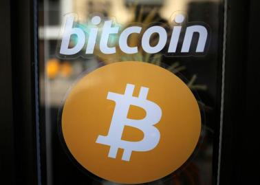 A sign is seen outside a business where a Bitcoin ATM is located in Toronto, Ontario, Canada June 3, 2017. REUTERS/Chris Helgren - RC1685377DB0