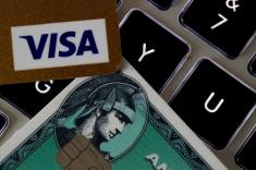 An American Express and a Visa credit cards are seen on a computer keyboard in this picture illustration taken September 6, 2017. REUTERS/Philippe Wojazer/Illustration - RC168FE69600