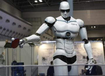 "Pingpong-playing robot ""Topio"" is displayed during the InternationalRobot Exhibition 2009 in Tokyo November 25, 2009. The bipedal humanoidrobot is designed to play table tennis against a human being.REUTERS/Kim Kyung-Hoon (JAPAN SCI TECH SOCIETY HEALTH) FOR BEST QUALITY: ALSO SEE GM1E5CI16M901. - GM1E5BP17KE01"