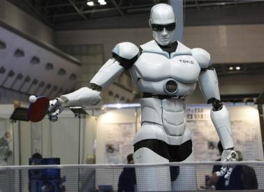 """Pingpong-playing robot """"Topio"""" is displayed during the InternationalRobot Exhibition 2009 in Tokyo November 25, 2009. The bipedal humanoidrobot is designed to play table tennis against a human being.REUTERS/Kim Kyung-Hoon (JAPAN SCI TECH SOCIETY HEALTH) FOR BEST QUALITY: ALSO SEE GM1E5CI16M901. - GM1E5BP17KE01"""